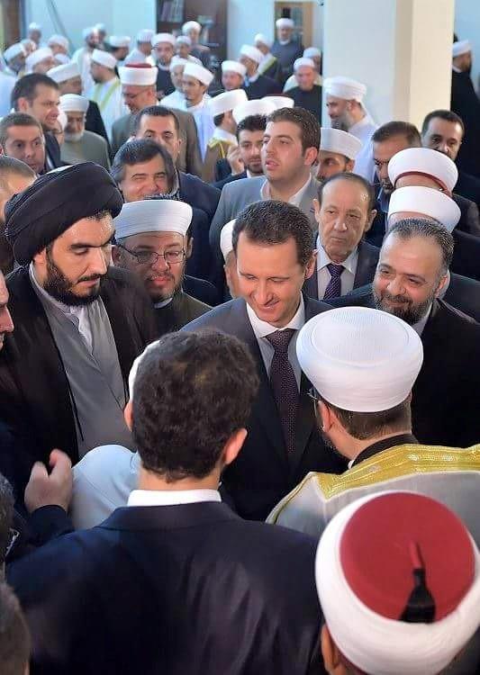 بعد صلاة عيد الفطر مرافقًا لبشار الأسد