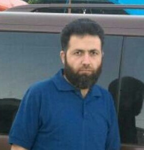الدكتور أحمد الأسعد، مدير مشفى الشهيد عدي أبو حسين في مدينة سراقب