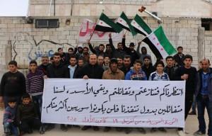 لافتة من مظاهرة كفرنبل 19 كانون الأول 2015