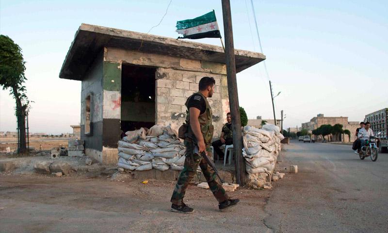 تعبيرية، لمقاتل من الجيش الحر في مارع شمال حلب عام 2012