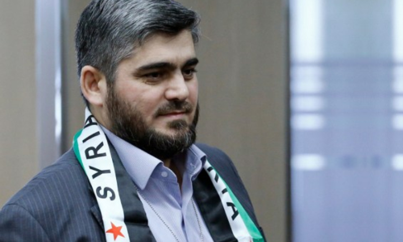 """محمد علوش رئيس المكتب السياسي في """"جيش الإسلام"""" من جنيف- 22 آذار 2016 (AFP)."""