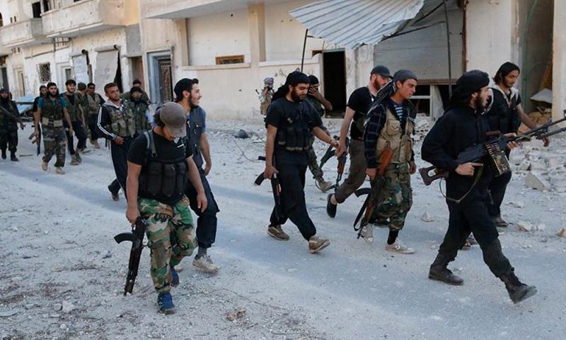 """مقاتلون من """"جند الأقصى"""" في مدينة مورك شمال حماة- تشرين الأول 2015 (تويتر)"""