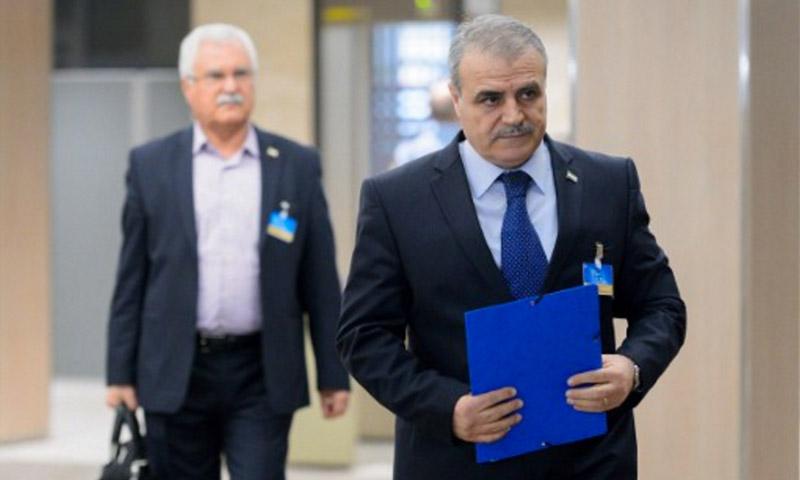 رئيس وفد الهيئة العليا، العميد أسعد الزعبي، وعضو الهيئة جورج صبرا، في جنيف 15 نيسان 2016 (AFP)