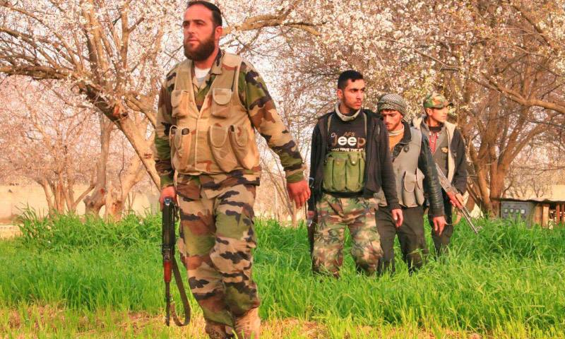 """أرشيفية- عناصر من """"جيش الإسلام"""" في الغوطة الشرقية"""