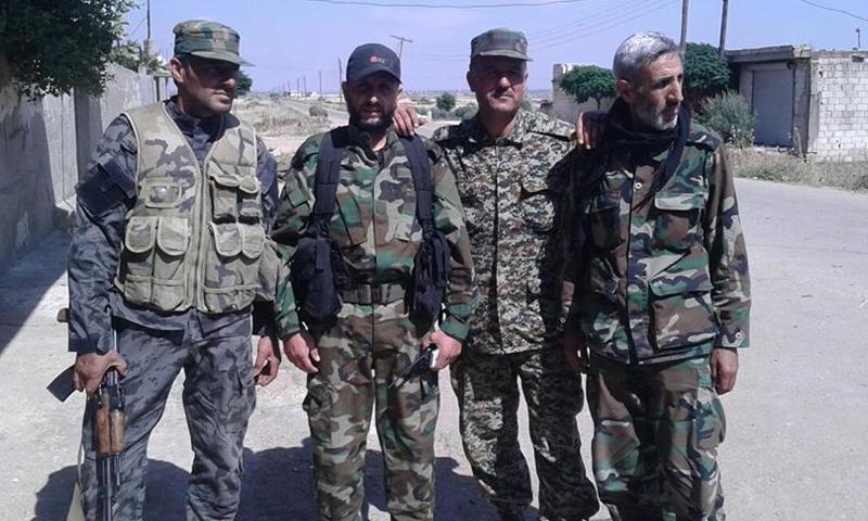 """عناصر من ميليشيا """"الدفاع الوطني"""" على أطراف بلدة الزارة، الجمعة 20 أيار (فيس بوك)."""