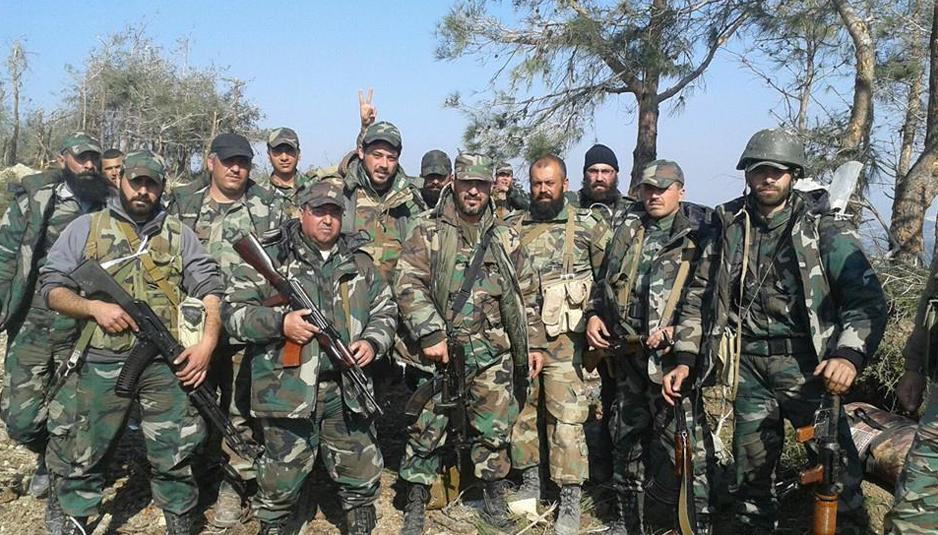 """عناصر من ميليشيا """"أسود الحسين"""" في ريف اللاذقية الشمالي (فيسبوك)."""