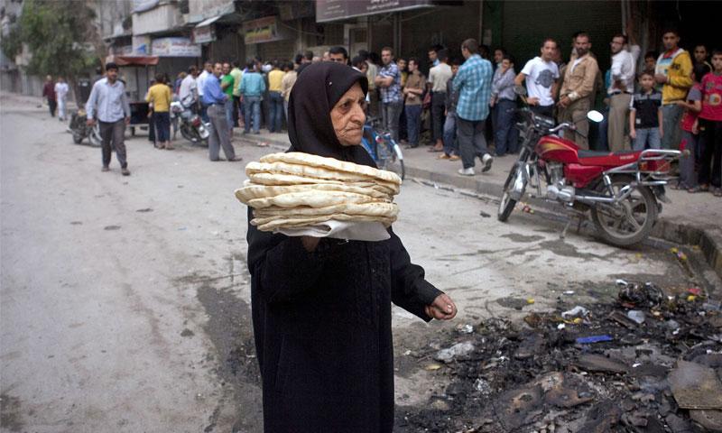 الازدحام على الافران في سوريا(انترنت)