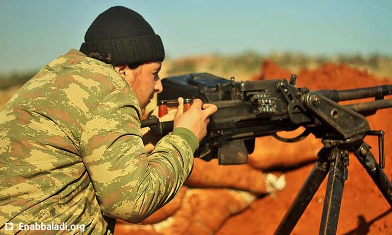 """صورة أرشيفية لمقاتل من """"جيش الفتح"""" (عنب بلدي)."""
