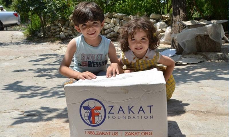 توزيع مساعدات على السورين(زكاة zv)