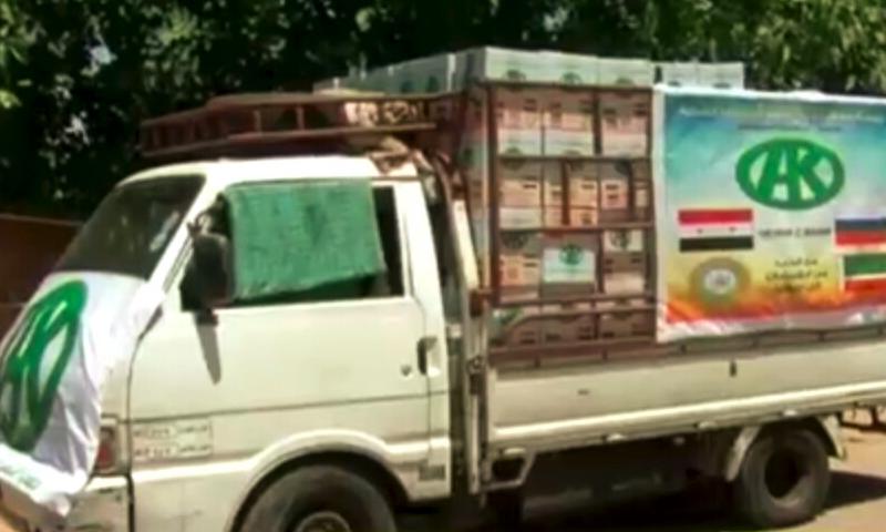 سيارات المساعدات في مزارع شواقة (إنترنت)