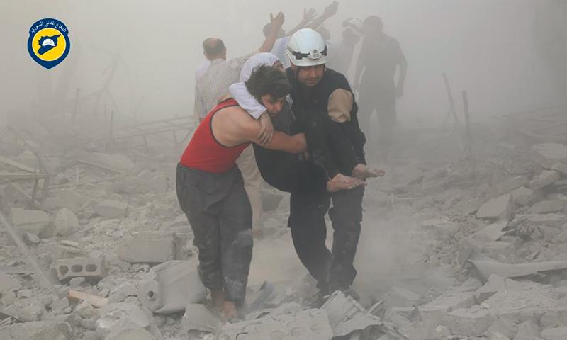 قصف الطيران المروحي على حي طريق الباب في حلب 7 تموز ( مركز الدفاع المدني)