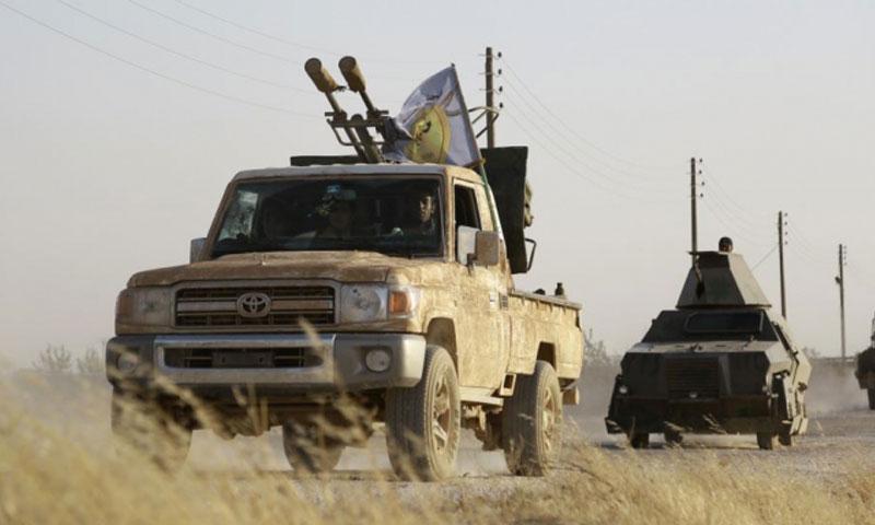 """آليات تابعة لـ""""المجلس العسكري في منبج"""" (AFP)"""