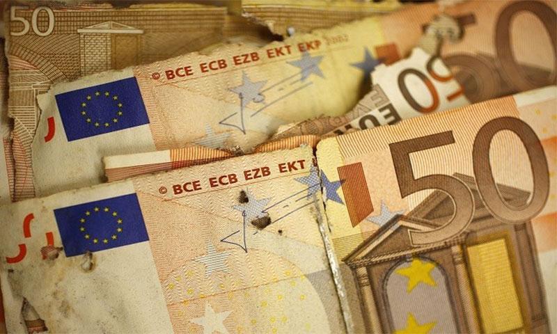 قطع نقدية من فئة 50 يورو (رويترز)