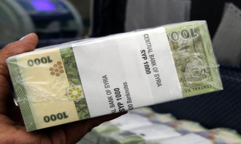 حزمة قطع نقدية من فئة الألف ليرة سورية (إنترنت)