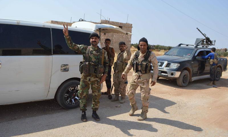 """عناصر من """"سوريا الديمقراطية"""" في قرية حربل- الأربعاء 31 آب (جيش الثوار)"""