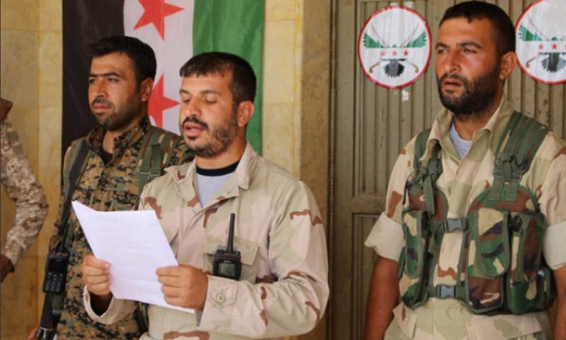 عبد الستار الجادر، قائد مجلس جرابلس العسكري خلال تلاوته بيان تشكيل المجلس - 21 آب (يوتيوب)