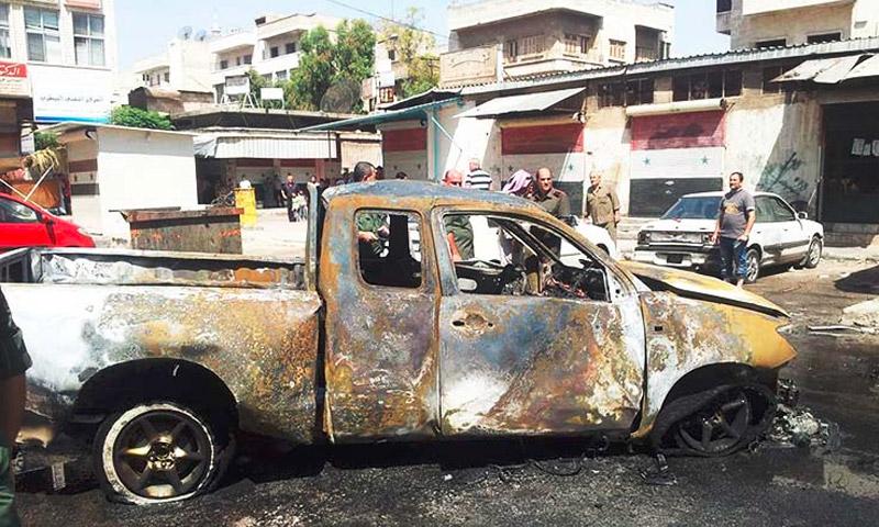 سيارة انفجرت داخلها عبوة ناسفة داخل حي الشمالية في حماة 5 أيلول 2015 (أرشيفية)