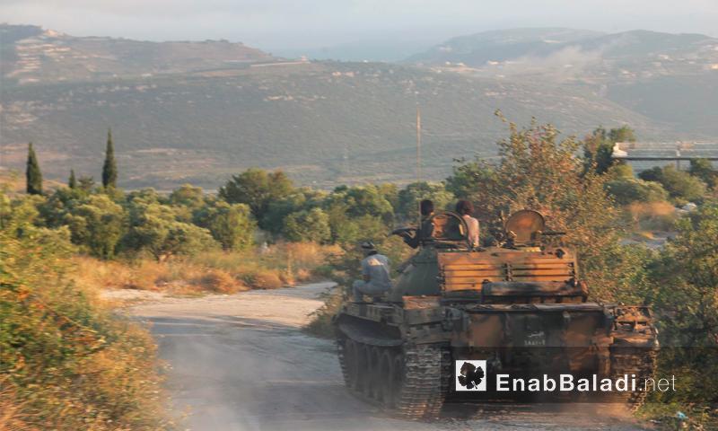 مقاتلو المعارضة على جبهة قلعة شلف - 16 تموز (أرشيف عنب بلدي)