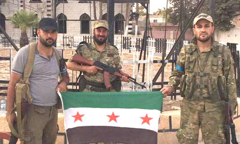 """مقاتلون من """"الجيش الحر"""" في مدينة جرابلس- الأربعاء 24 آب (تويتر)"""