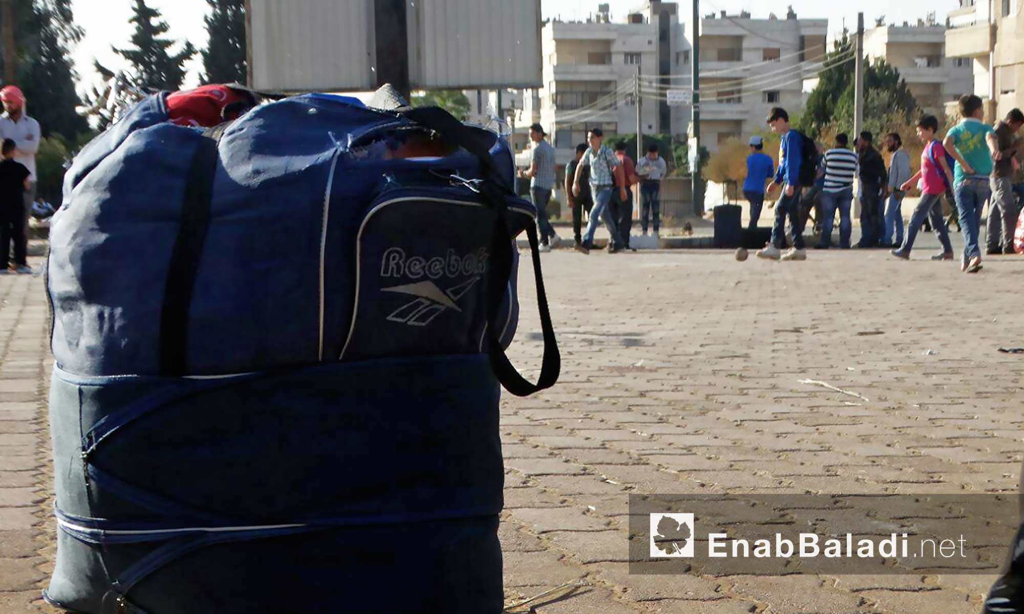 أهالي حي الوعر يتجهزون للذهاب إلى ريف حمص الشمالي - 26 أيلول 2016 (عنب بلدي)