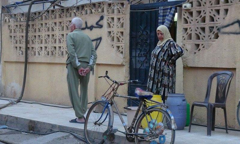 عبوات المياه في حي مساكن الحزب (الشهداء حاليًا) - نيسان 2013