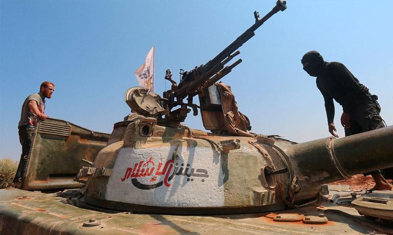 """تعبيرية: مقاتلون في فصيل """"جيش الإسلام"""" (إنترنت)"""