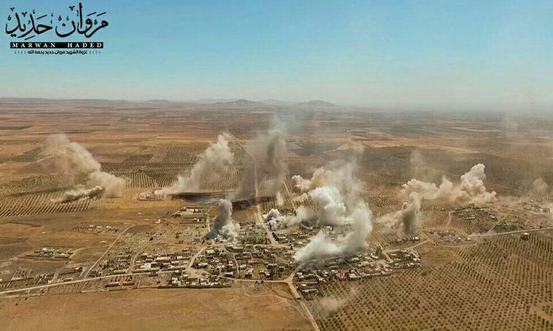 صورة جوية لبلدة معان بالتزامن مع التمهيد المدفعي والصاروخي عليها- السبت 24 أيلول (جند الأقصى)