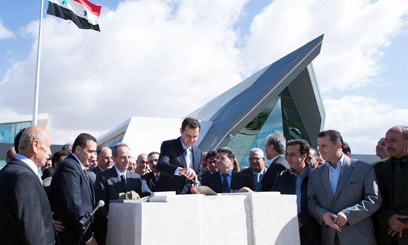 الأسد يضع حجر الأساس لمشروع تنظيم_66 خلف الرازي في آذار الماضي (انترنت)
