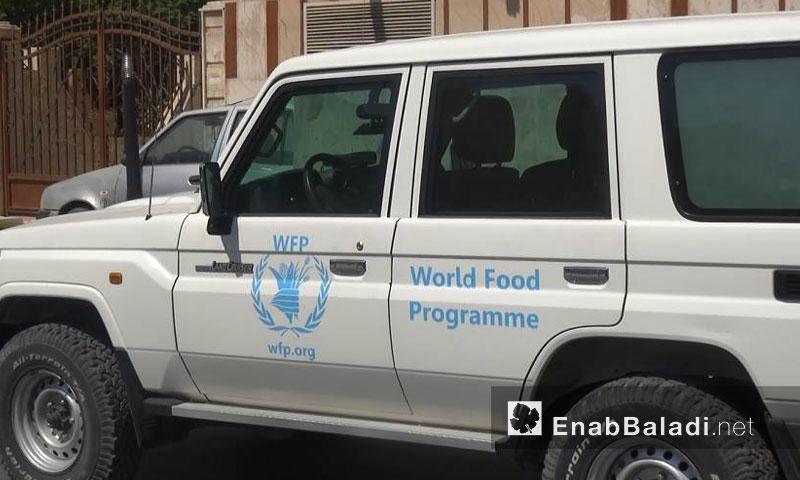 من أمام مبنى الأمم المتحدة في القامشلي (عنب بلدي)