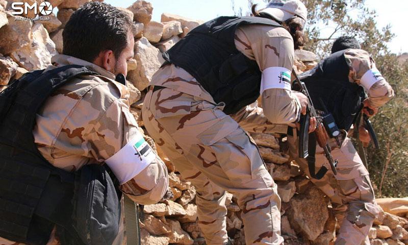 """أرشيفية- عناصر من """"الجيش الحر"""" في درعا (الهيئة السورية للإعلام)"""