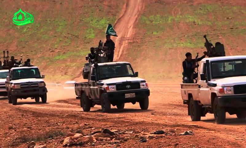 """تعبيرية لمقاتلي فصيل """"جيش اليرموك"""" في درعا (إنترنت)"""