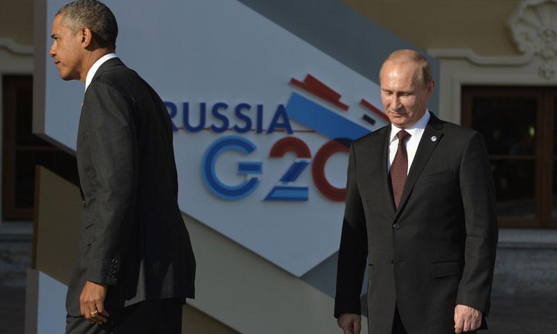 الرئيس الأمريكي باراك باراك أوباما ونظيره الروسي فلاديمير بوتين (AFP)