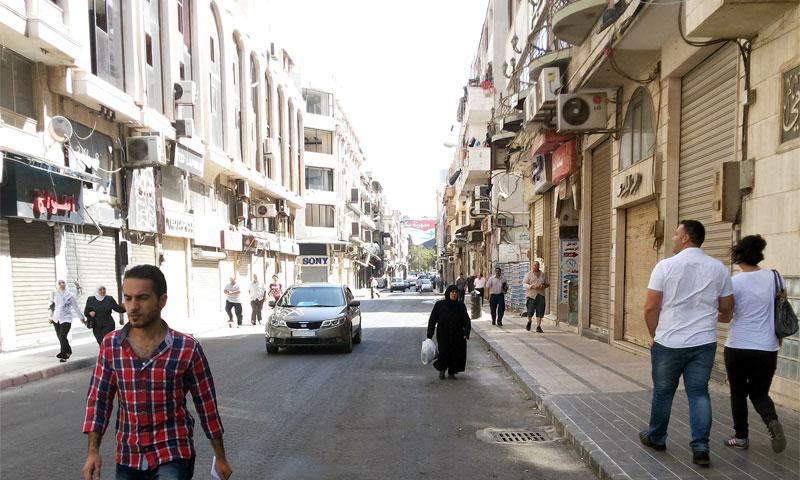 شارع الدبلان وسط مدينة حمص أيلول 2014 (سانا)