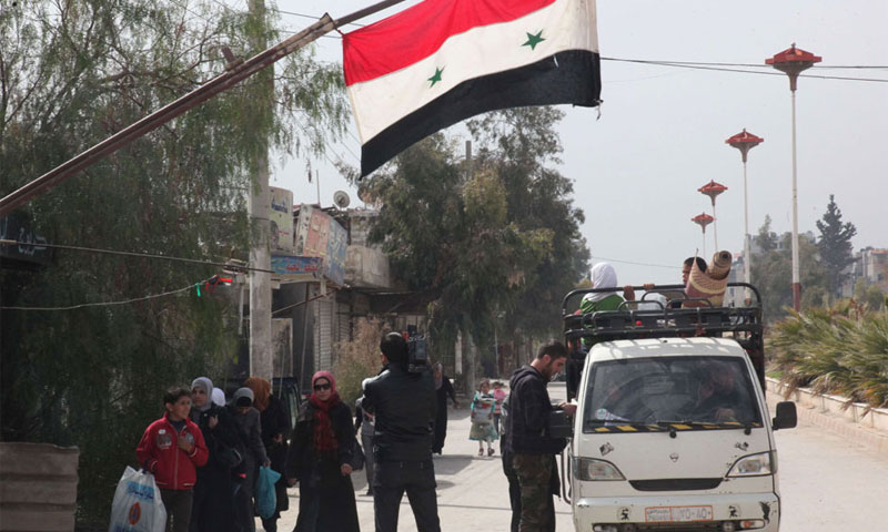 أحد حواجز النظام في دمشق في 2014 (AFP)أحد حواجز النظام في دمشق في 2014 (AFP)