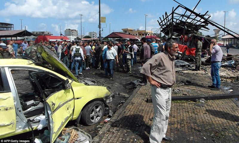 """تعبيرية: آثار تفجيرات طرطوس التي وصفت بالـ """"الإرهابية"""" - 24 أيار 2016 (AFP)"""
