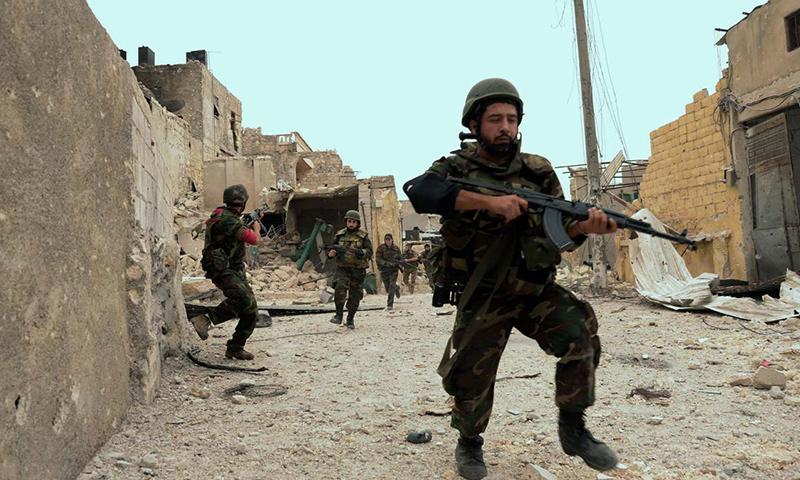 أرشيفية- عناصر من قوات الأسد (وكالات)
