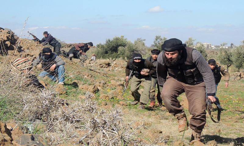 عناصر من جيش خالد بن الوليد في الجنوب السوري_(انترنت)عناصر من جيش خالد بن الوليد في الجنوب السوري_(انترنت)
