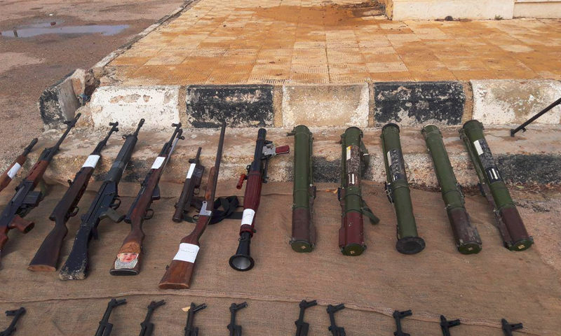 أسلحة سُلّمت للنظام في بلدة الصنمين بدرعا - 25 كانون الأول 2016 (سانا)