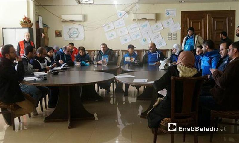 جانب من زيارة الوفد الأممي إلى حي الوعر- الأربعاء 7 كانون الأول (عنب بلدي)
