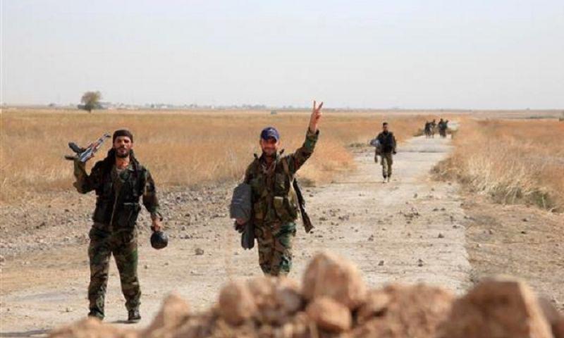 عناصر من قوات الأسد في محيط مطار كويرس_(انترنت)