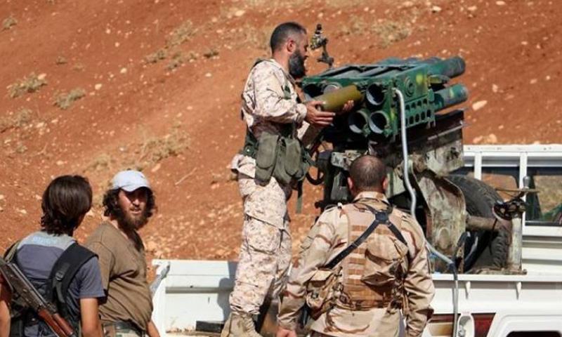 عناصر من فصائل الجيش الحر في ريف مدينة درعا_(انترنت)
