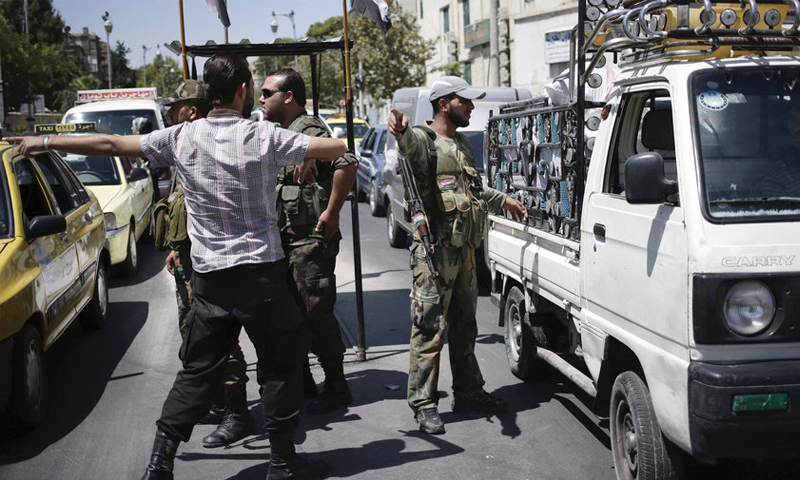 تعبيرية: حاجز لقوات النظام السوري في مدينة دمشق (انترنت)
