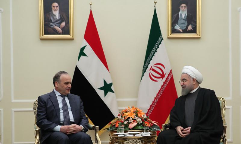 رئيس الوزراء السوري، عماد خميس، في اجتماع مع الرئيس الإيراني حسن روحاني في طهران - 18 كانون الثاني 2017 (AFP)