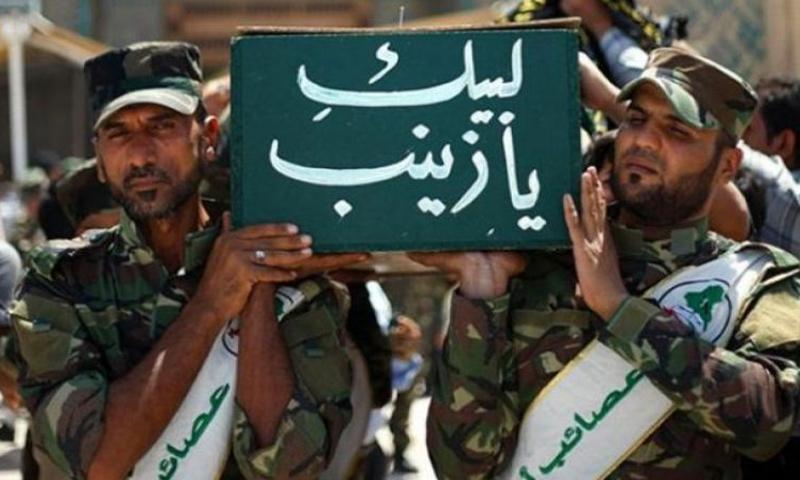 مقاتلين من الحرس الثوري الإيراني يقومون بتشييع مقاتل إيراني قتل في سوريا_(انترنت)
