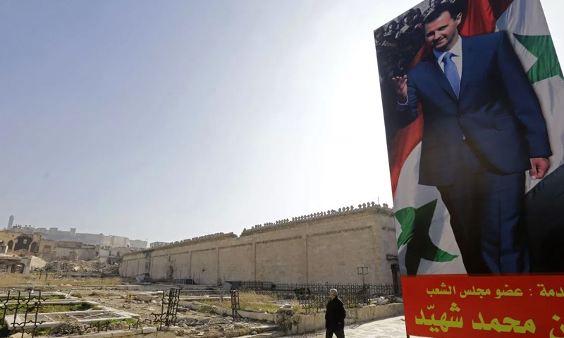 لافتة لرئيس النظام السوري بشار الأسد_(AFP)