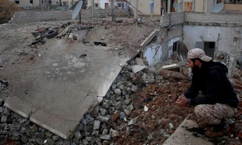 آثار قصف الطيران الحربي على مدينة درعا_17 شباط_(AFP)