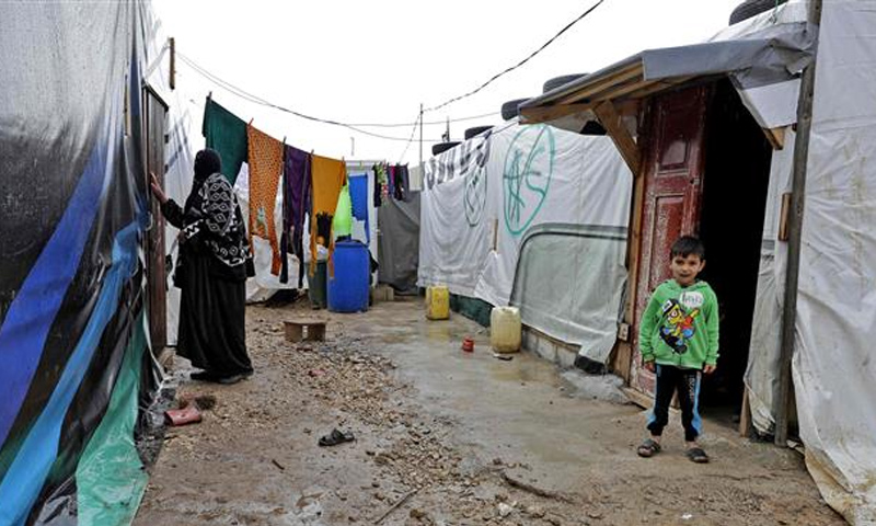 اللاجئين السوريين داخل المخيمات اللبنانية_(AFP)