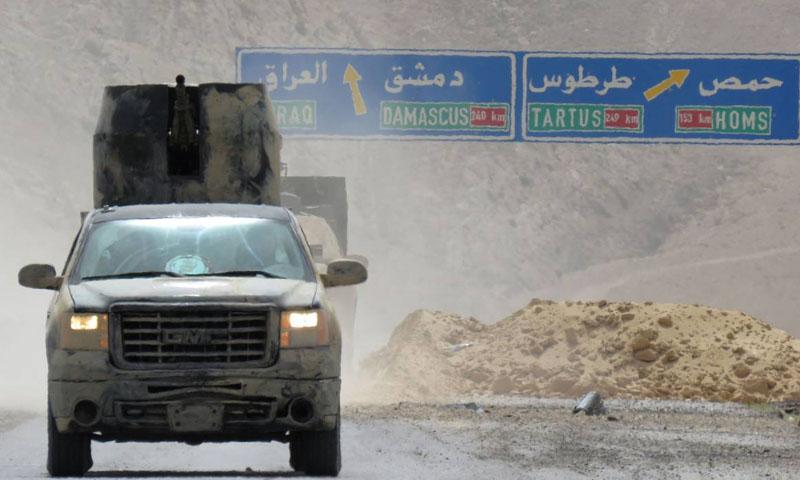 آلية تابعة لقوات الأسد في محيط مدينة تدمر - (انترنت)