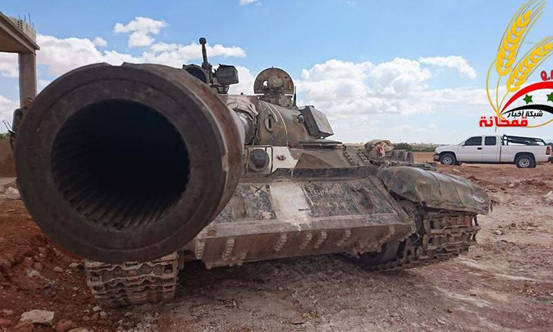 دبابة تابعة لقوات الأسد في بلدة قمحانة شمال حماة- الأحد 27 آذار (فيس بوك)