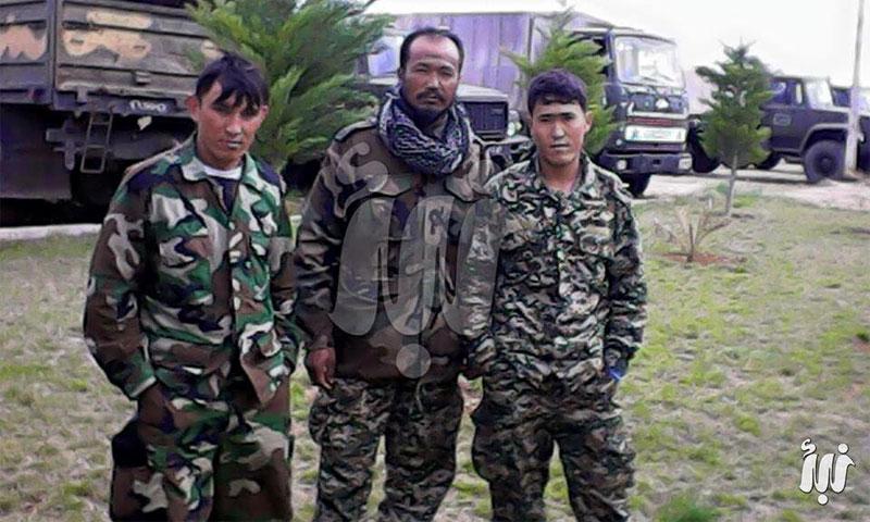 مقاتلون أفغان داخل جامعة اليرموك بدرعا - 2015 (وكالة نبأ)